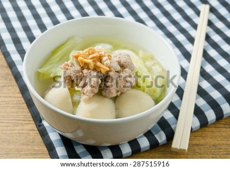 Thai Cuisine and Food, Bowl of Delicious Chinese Cabbage with Minced Pork and Fish Meat Ball Soup Topping with Fried Garlic. - stock photo