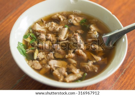 ... thai clear spicy hot and sour soup with beef entrails in a bowl