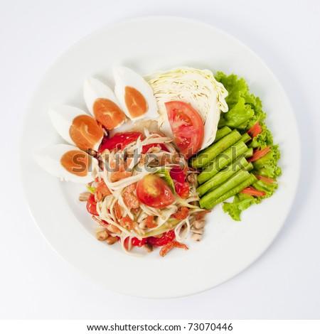 thai cuisine - hot and spicy papaya salad - stock photo