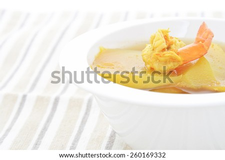 Thai curry with tamarind sauce, shrimp and vegetables : Delicious thai traditional food (kang som koong) - stock photo