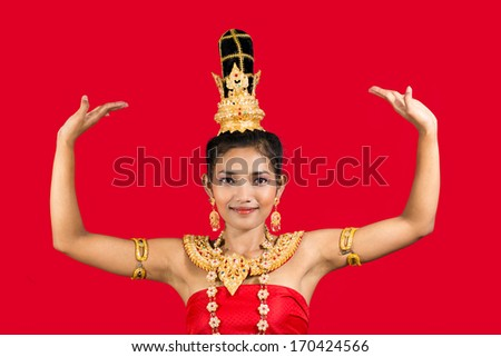 Thai dancer against a red background.