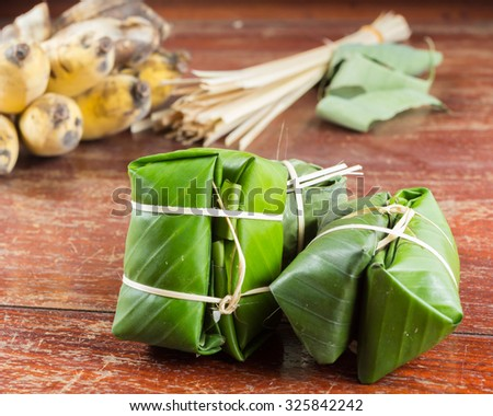 Thai dessert made from rice and banana wrapped in banana leaves,Traditional sweets.