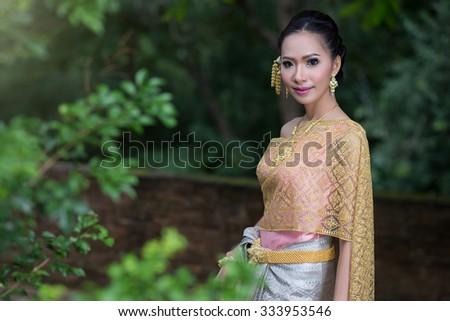 thai dress,Thai women wearing typical Thai dress, identity culture of Thailand - stock photo