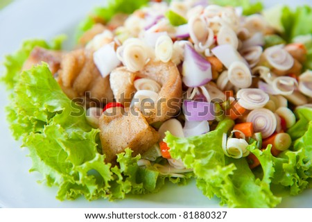 Thai dressed spicy salad with bass, green herbs and nuts : delicious food - stock photo
