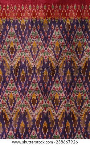 Thai fabric pattern close up texture. - stock photo
