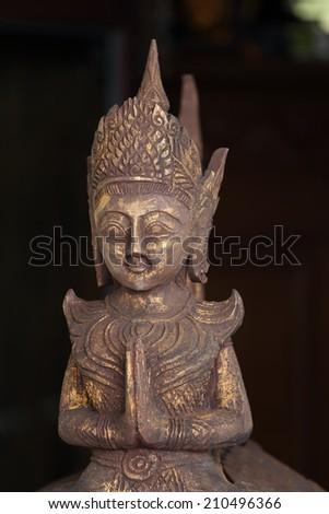 Thai figure detail of deva with black background - stock photo