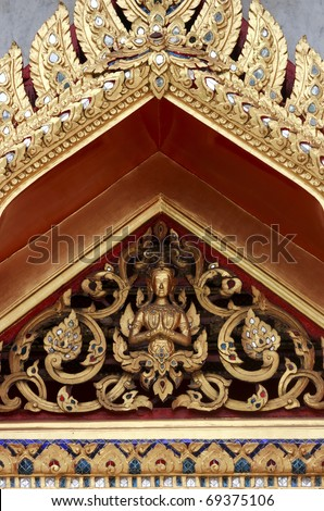 Thai figures and shapes on buddhist temple - stock photo