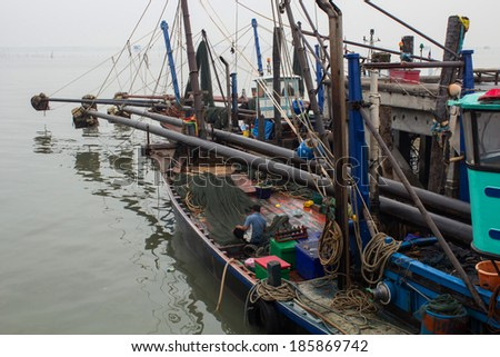 Thai fishing boat used as a vehicle for finding fish in the sea - stock photo