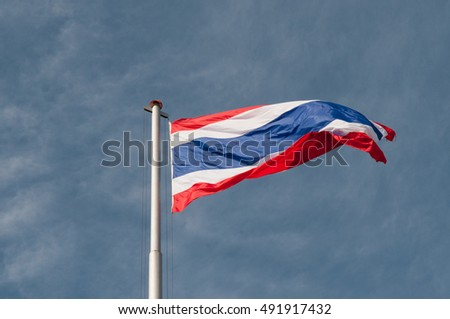 Thai Flag three color on the pole with windy  sky.