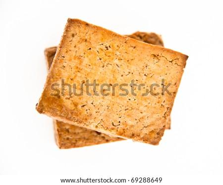 Thai Flavored Tofu Blocks on White Background - stock photo