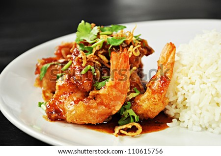 Thai food - deep fried prawns in Tamarind sauce with steam rice - stock photo