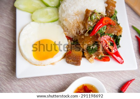 Thai food fried basil with crispy pork and  eeg or Pad kra prao moo