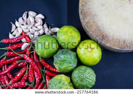 Thai food herb chili,lime,garlic with kitchen tool - stock photo