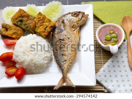 Thai food Nam prik pla two mackerel serve with Senegalia pennata Omelette and shrimp paste - stock photo