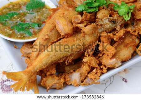 Thai food name is Deep fried Silver banded fish with garlic pepper and spicy sauce