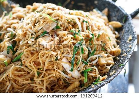 Thai food - Padthai hot in pan - stock photo