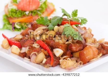 Thai food, pork fried herbs on white background. - stock photo