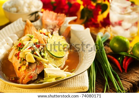 Thai food - Red snapper with garlic, chili, lemon grass and lemon - stock photo