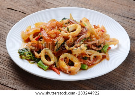 Thai Food Spicy squid Curry and  shrimp - stock photo