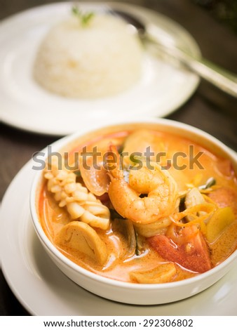 Thai food : Tom Yum sea food soup on the wood texture