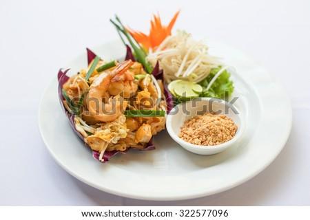 Thai fried noodle on white dish - stock photo