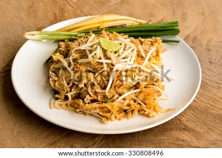 Thai Fried Noodles, Pad Thai one of Thailand's national main dish, Thai style food on wood background