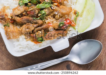 Thai fried pork basil sauce eating with rice.