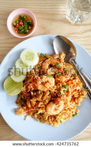 Thai fried rice with spicy Tom Yum Goong (Prawns) sauce - stock photo