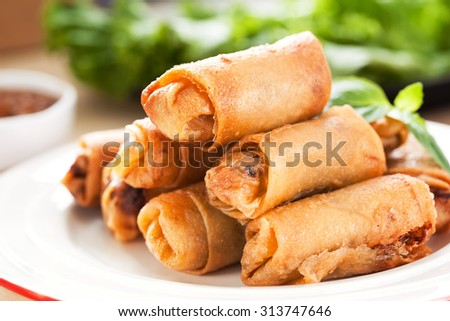 thai fried spring roll pile on plate - stock photo