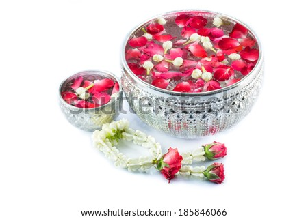 Thai garland Flowers and Water with jasmine and roses corolla in bowl isolated on white background (Use for Songkran festival in Thailand)