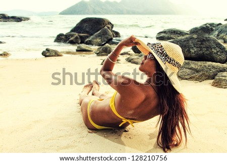 Thai girl on the beach - stock photo