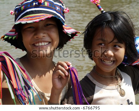 THAI GIRLS AT MAE PING RIVER