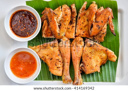 Thai grilled chicken with spicy sauce - stock photo