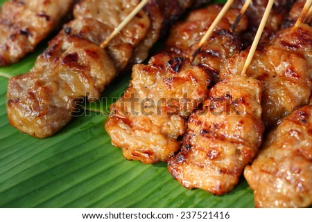 thai grilled pork place on banana leaf for sale in market - stock photo