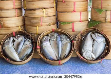 Thai gulf mackerel fish steamed on bamboo basket in different sizes for display at a fish market ; Thai people called this fish is Pla-too - stock photo