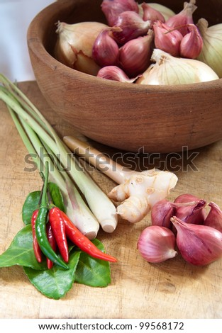 Thai herb ingredients for Tom Yum in wooden bowl