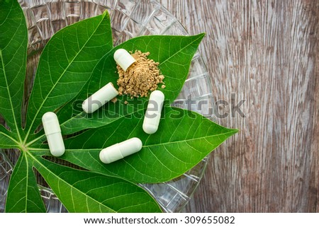 Thai herbal in capsules from ginger and Bengal root with selective focus, dark soft light - stock photo