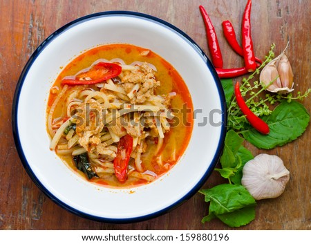 Thai hot and spicy curry with chicken and bamboo shoot on table  - stock photo
