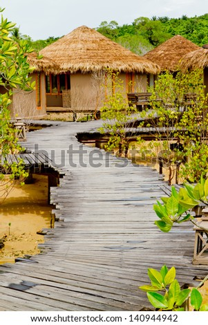 Thai huts style in mangrove forest - stock photo
