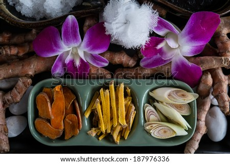 thai ingredients for spa treatment in bowls with flower decoration - stock photo