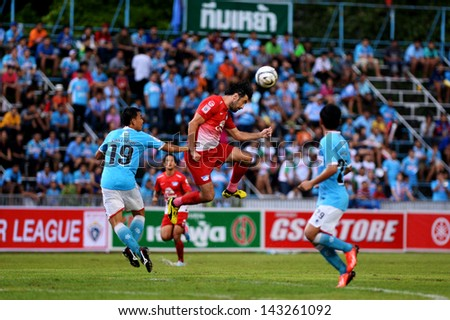 THAI-Jun22:Ivan Boskovic(R)of Chonburi F.C Jump tackles football Thai Premier League between samutsongkhram fc and Chonburi F.C.at Samut Songkhram Stadium on June22,2013 in Samutsongkram,Thailand.