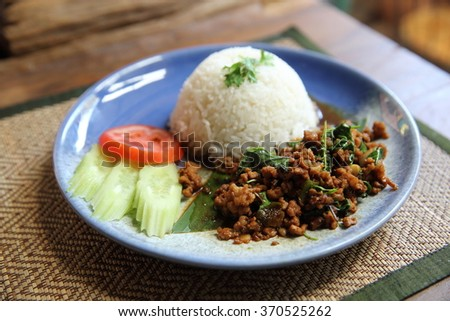 Thai local food rice with pork and basil - stock photo