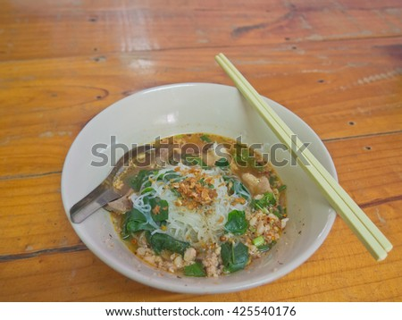 Thai local style pork rice noodle with Ivy Gourd vegetable - stock photo