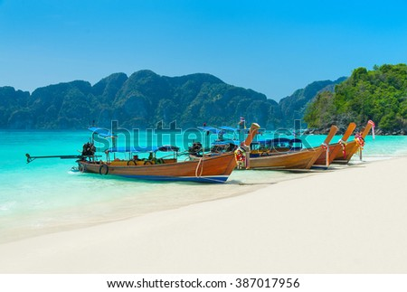 Thai longtail boats at Long Beach (Had Yao beach), Thailand, Krabi province, best Phi Phi Don island beach - stock photo