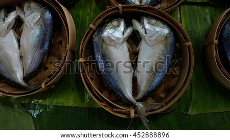 Thai mackerel fish steamed on bamboo basket - stock photo