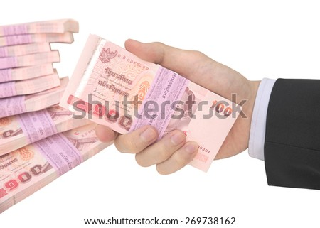 Thai Male hand handling pack of 100 banknotes of 100 baht with pile of pack of 100 banknotes of hundred baht background isolated on white