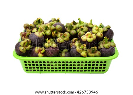 Thai mangosteen in green basket with isolated on white background - stock photo
