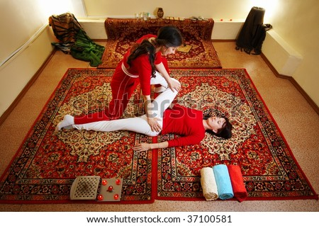 Thai massage is a type of massage in Thai style that involves stretching and deep massage - stock photo