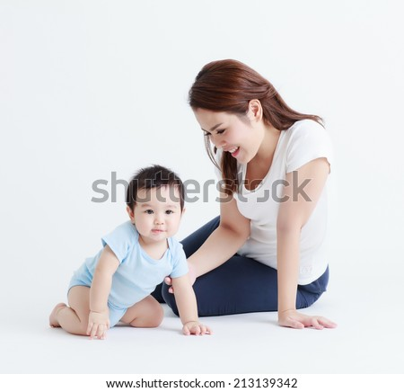 Thai mom and son smiling isolated - stock photo