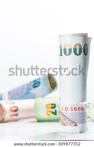 Thai money banknotes on white background. Selective focus point.